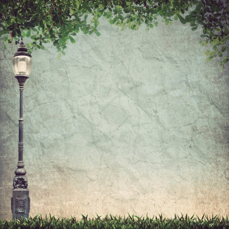 organic background: Lamp Street Road Light Pole and Green leave on old grunge paper