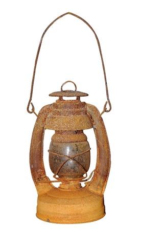 kerosene: Old dusty oil lamp isolated on white
