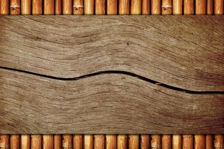 bamboo background: Wood board on bamboo background