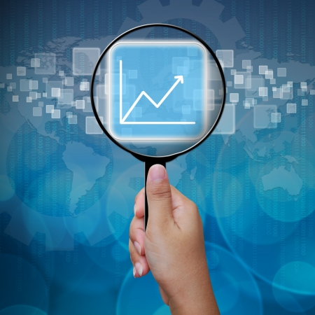 Graph button in Magnifying glass Stock Photo - 14957834