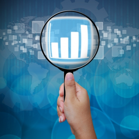 Graph button in Magnifying glass Stock Photo - 14957829