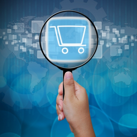 Shopping Cart button in Magnifying glass Stock Photo - 14957833