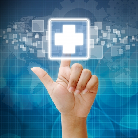 health technology: Hand press on First Aid icon Stock Photo