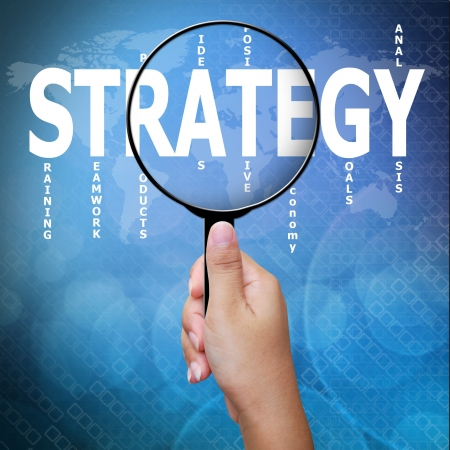Strategy, word in Magnifying glass ,Business concept Stock Photo - 15053314