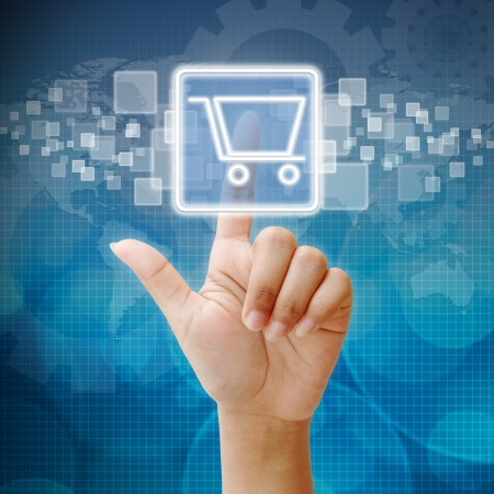 online marketing: Hand press on Shopping Cart icon Stock Photo