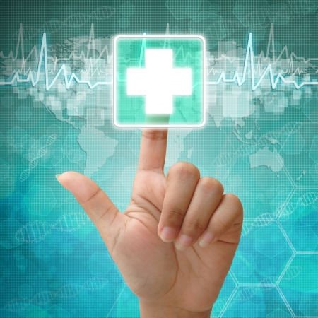 Hand press on First Aid Symbol , medical background