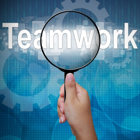 woman handle success: Teamwork, word in Magnifying glass ,business background Stock Photo