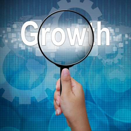Growth, word in Magnifying glass; business background photo