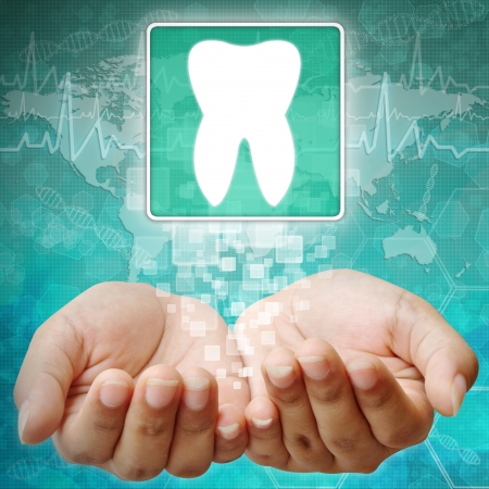holography: Tooth Symbol on hand,medical background