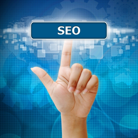 search engine optimized: Hand woman press on touch screen interface seo button Stock Photo