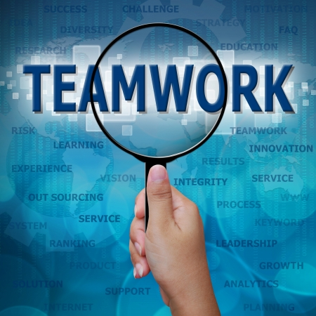 TEAMWORK in Magnifying glass on blue background Stock Photo - 18405441