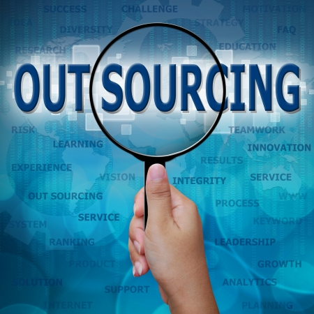 sourcing: OUT SOURCING in Magnifying glass on blue background