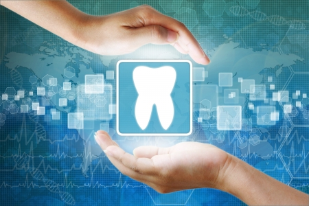 holography: medical icon, Tooth symbol in hand