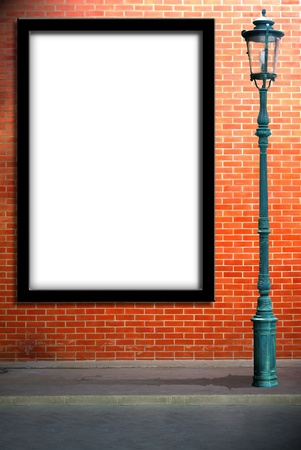 Lamp post street and blank billboard on brick wall photo