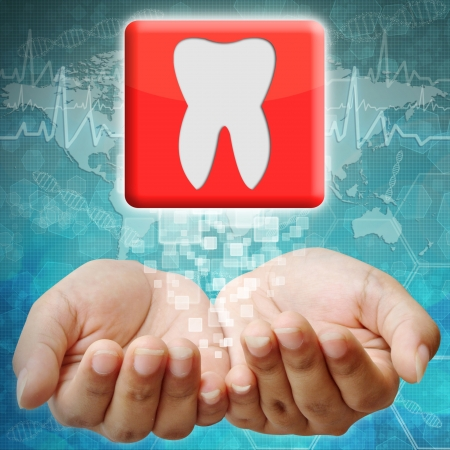 holography: Tooth icon on hand ,medical background