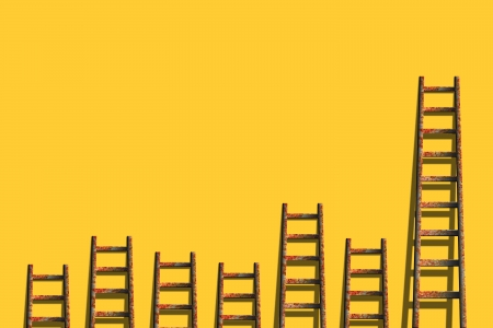 business competition: Old ladders on blank yellow wall