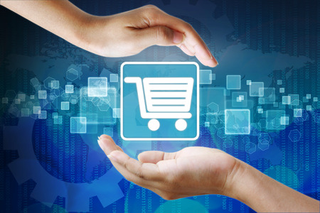Shopping cart icon in hand  Stock Photo