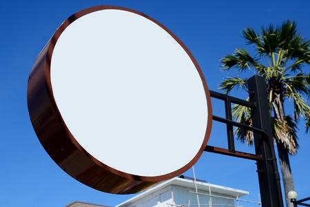 shop sign: Signboard on blue sky