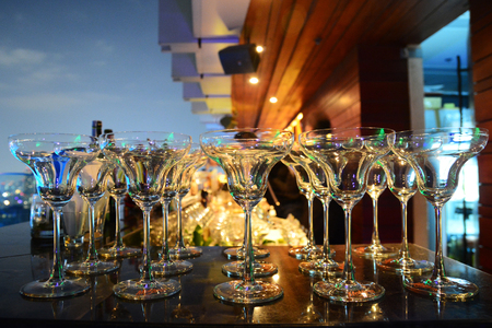 food and drink: Empty glasses in row background at restaurant party