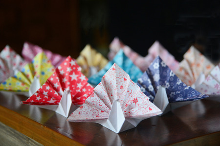 crane origami: Colorful Origami birds flying to the light.