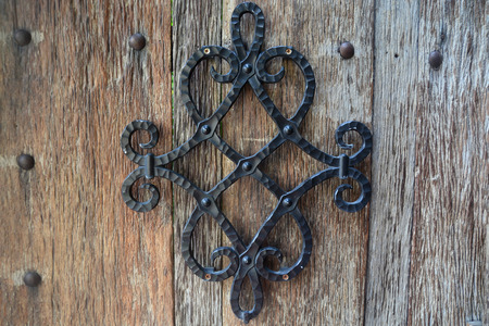 Metal ornament on a wooden planks Banque d'images