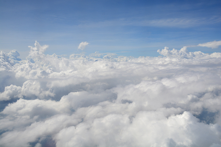 View from the window of an airplane flying in the clouds