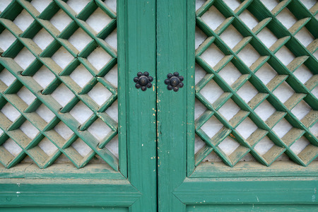 Old wooden door with round handles