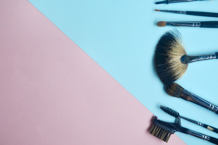 Creative flat lay of set of brush on pastel background, Minimal cosmetic beauty product concept with copy space 版權商用圖片