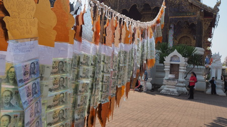 a group of binded banknote performing of Lanna beliefs,Chaingmai,Thailand.