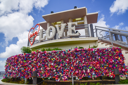 Two lovers point look out view point with Love,GUAM, Red Heart sign: Close up view with many locks Banque d'images