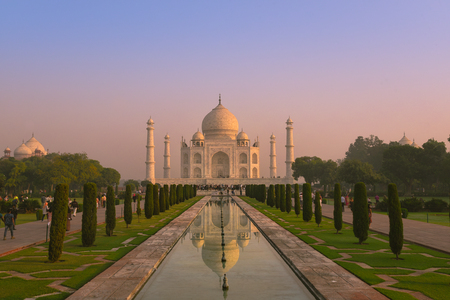 Sunrise at Taj Mahal (Crown of the Palace) is a is an ivory-white marble mausoleum on the south bank of the Yamuna river in the Indian city of Agra. It is one of the Seven Wonders of the world. Editorial