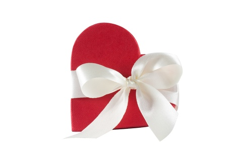 red heart shaped gift box over white background photo