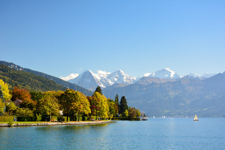 cpl: Lake Thun with Jungfrau mountain in autumn on clear blue sky , Switzerland, Shot using CPL  filter