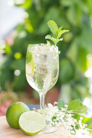 summer drink Hugo Champagne drink with elderflower syrup mint and lime Stock Photo