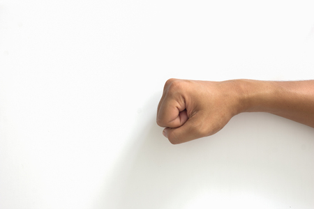 gesticulation: Closeup of right male hand clenched fist isolated over white background