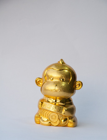 lucrative: gold monkey with gold coin and chinese words mean lucrative for chinese new year.