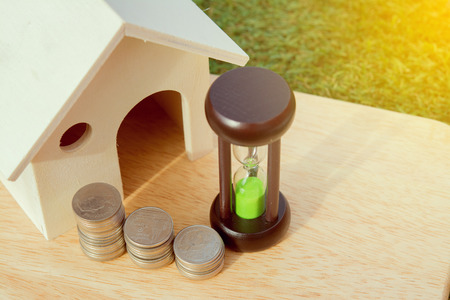 Loans to finance home building.Money Hourglass home.