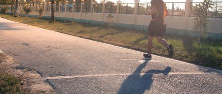 man running on street with sunset background Stockfoto