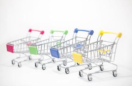 multicolored of mini shopping cart on white background Stock Photo