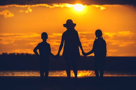 some family silhouette at sunset