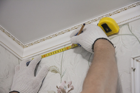 Repair and design of premises. Marking for curtain rod. 스톡 콘텐츠