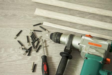 Interior repair. Preparation for installation of floor skirting boards 스톡 콘텐츠
