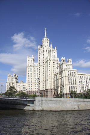 Architecture in Empire style. The building of the skyscraper of the Stalin era on the Kotelnicheskaya embankment and the Moscow River, Moscow, Russia