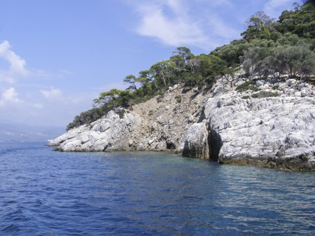 Beautiful natural landscape sunny summer day. Panorama of a stone island among the sea,