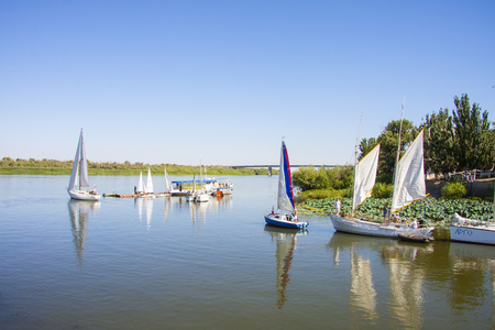 ASTRAKHAN, RUSSIA - AUGUST 31 2014: Sailing boats in the summer on the Volga River, Astrakhan, Russia, 2014 Reklamní fotografie - 120357454