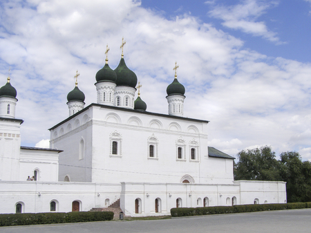 White Orthodox Church with black domes in summer