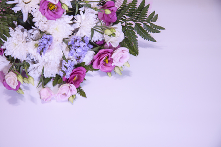 A modern, beautiful floral bouquet on a purple