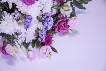 A modern, beautiful floral bouquet on a purple Reklamní fotografie - 120632486