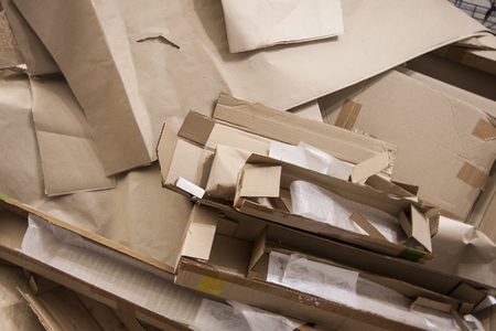 Various cardboard boxes. Waste production. Paper packaging.