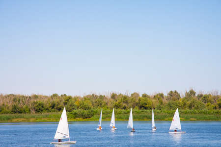 ASTRAKHAN, RUSSIA - AUGUST 31 2014: Sailing boats in the summer on the Volga River, Astrakhan, Russia, 2014